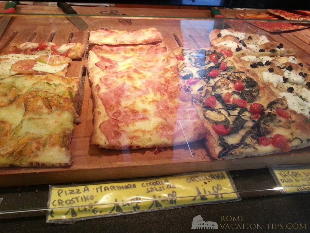 Pizza in Rome. Left-to-right: zucchini flower; ham; zucchini and tomato; and buffalo mozzarella pizza slices